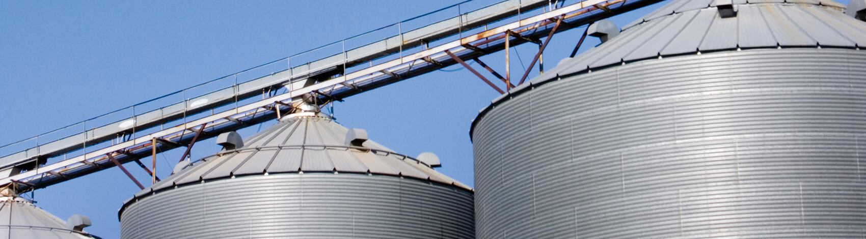 Agricultural silos painted with Jetcoat fibered aluminum roof coating